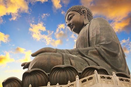 Giant Buddha sitting on lotusl. Hong Kong photo