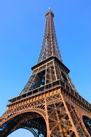 'tour eiffel': Eiffel tower close-up against blue sky, Paris, France. Stock Photo