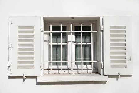 jalousie: Window of old house with jalousie. Paris, France