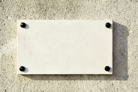 nameboard: Blank marble signboard close-up over wall