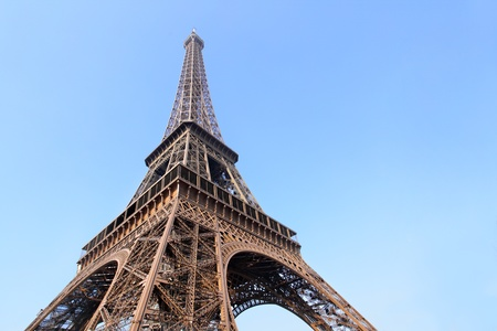 Eiffel tower close-up against blue sky, Paris, France. photo