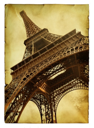 Vntage postcard with Eiffel tower isolated over white background photo