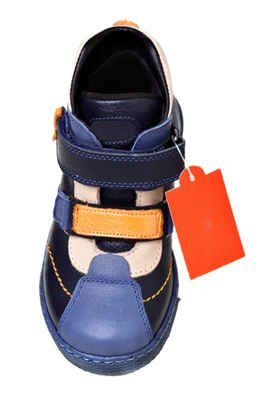 Childrens shoe with tag isolated over the white background  photo