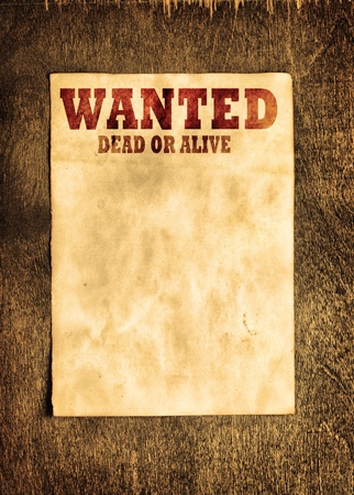 Vintage wanted poster on wooden wall photo