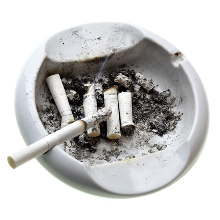 Ashtray with cigarette butts isolated over white background  photo