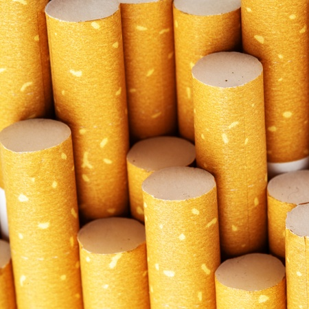 cropping: Yellow cigarette filters close-up, square cropping