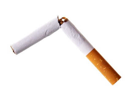 Broken cigarette isolated over the white background photo