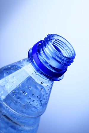 Top of bottle with pure water close-up photo