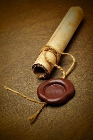 Manuscript with wax seal on a wooden table photo