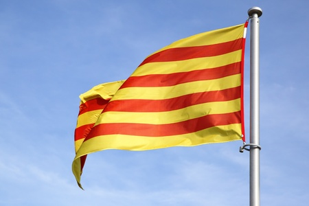 Catalan flag on pole is blowing in the wind close-up photo