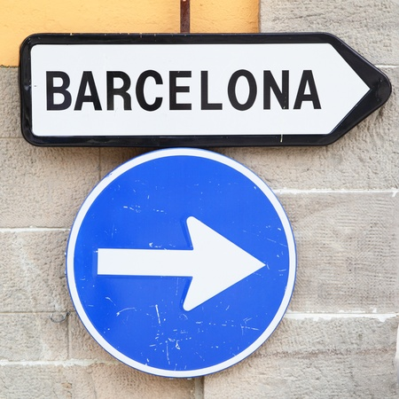 Road sign directive way to Barcelona city