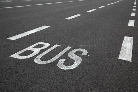 the carriageway: Road marking over black asphalt of carriageway