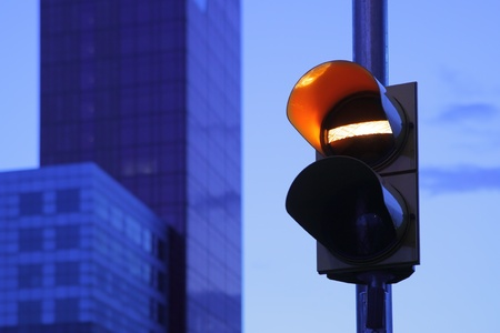inhibitory: Post with traffic lights at dusk close up Stock Photo