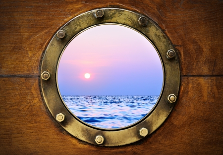 Boat porthole with ocean view close up Stock Photo