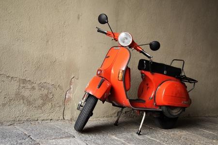 Vintage scooter Vespa P200E near wall close-up
