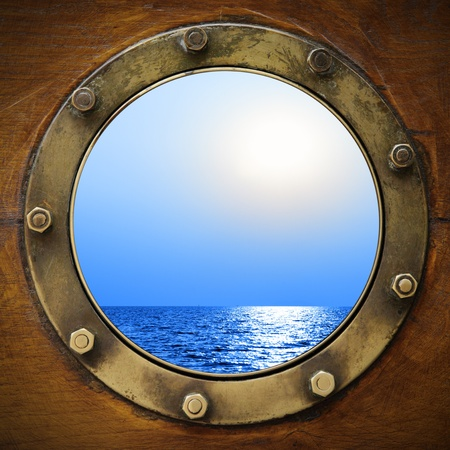 Boat porthole with ocean view close up photo