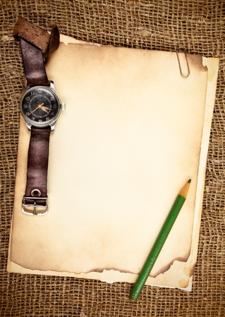 time table: Still-life with old blank papers and wristwatch Stock Photo