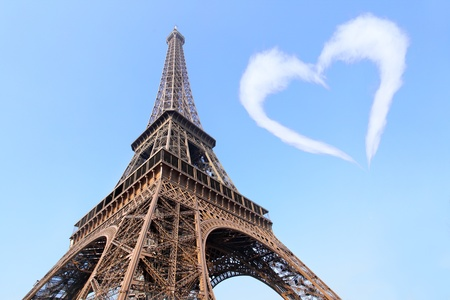 Eiffel tower and cloud-heart in blue sky photo