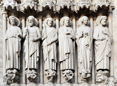 fasade: Saints on fasade of The Notre Dame de Paris. France. Stock Photo