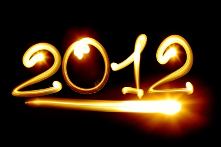 Happy new year 2012 message over black background Stock Photo - 10816058