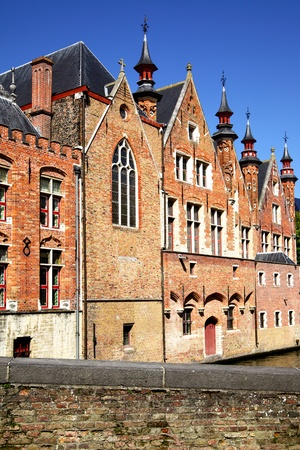 flemish: Medieval houses on canal in Bruges, Belgium