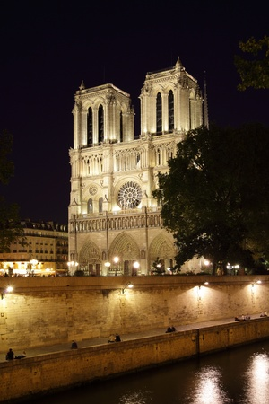 Night view of Notre Dame de Paris, France photo