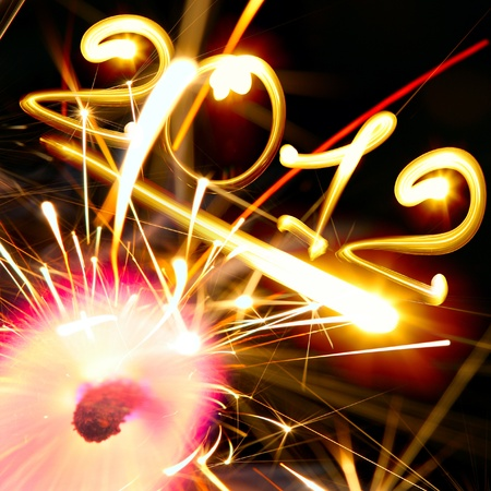 new year 2012 and sparkler on fire photo