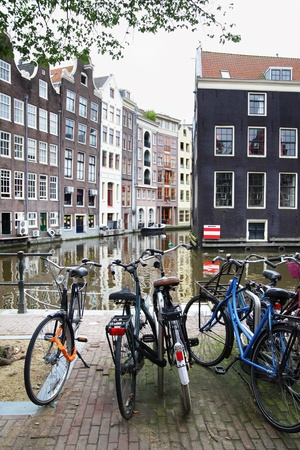 dutch landmark: Bicycles near canal in Amsterdam. Focus on the foreground!