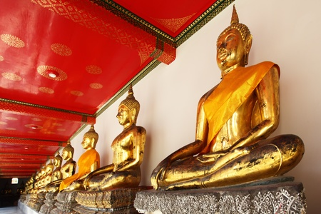 abreast: Gold statues of the Buddha abreast, Bangkok, Thailand