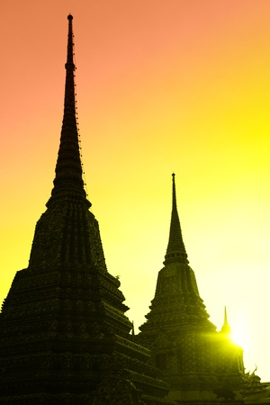 Silhouettes of stupas at Wat Pho temple, Bangkok, Thailand photo