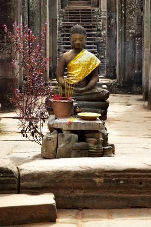 Buddha near entrance to Bayon temple, Angkor, Cambodia Stock Photo - 11986657