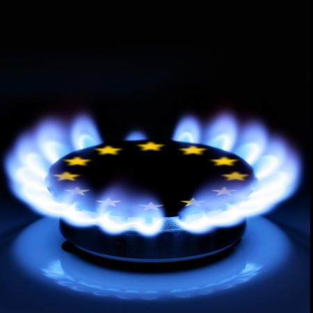 stove pipe: Gas flame and European Union Sign on the hob Stock Photo