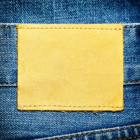 Blank leather label on jeans - space for your own text photo