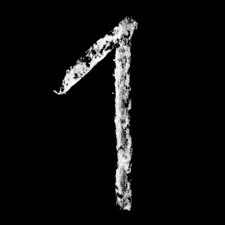 One - Chalk numbers over black background photo