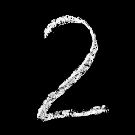 Two - Chalk numbers over black background photo