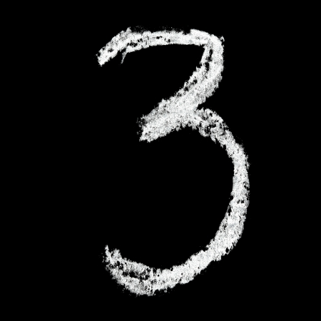 digit 3: Three - Chalk numbers over black background Stock Photo