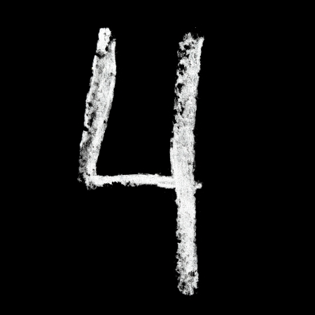 Four - Chalk numbers over black background photo