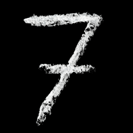 Seven - Chalk numbers over black background photo