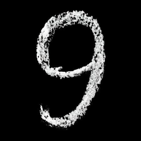Nine - Chalk numbers over black background photo