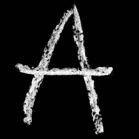 A - Chalk alphabet over black background photo