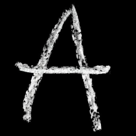 A - Chalk alphabet over black background photo