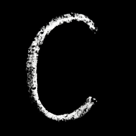 C - Chalk alphabet over black background photo