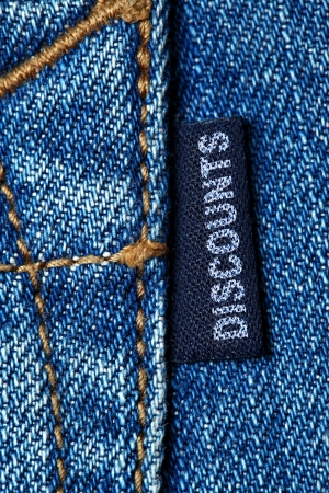 Blue jeans label with word DISCOUNTS photo