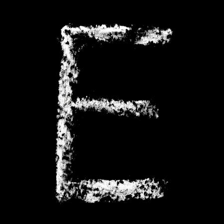 educaton: E - Chalk alphabet over black background Stock Photo