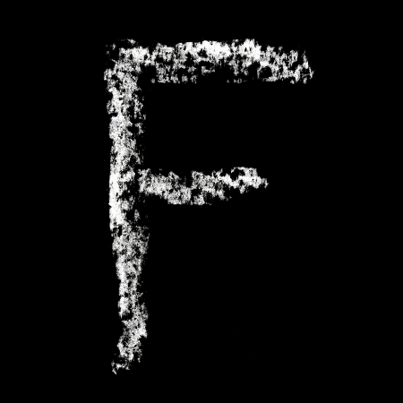 F - Chalk alphabet over black background photo