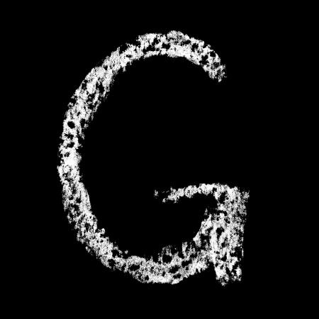 G - Chalk alphabet over black background photo
