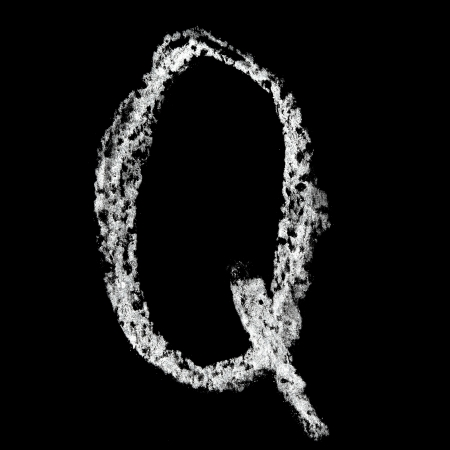 Q - Chalk alphabet over black background photo