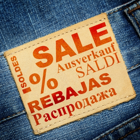 Jeans label with word SALE in different languages photo