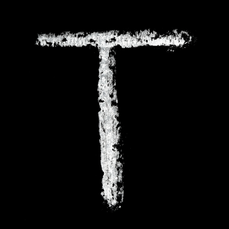 T - Chalk alphabet over black background photo