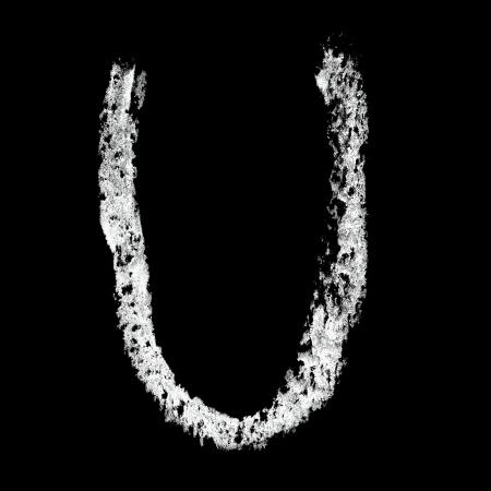 educaton: U - Chalk alphabet over black background